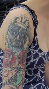 On Ina Forsman arm her dog Aloo
